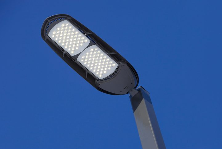 Polk Electric LLC | Illuminated LED Streetlight against a Clear Blue Sky